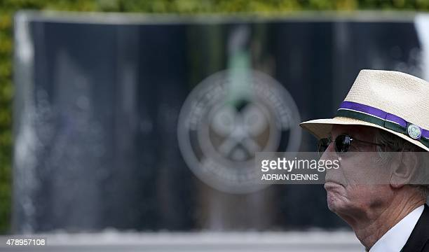 An honorary steward waits for the gates to open on day one of the 2015 Wimbledon Championships at The All England Tennis Club in Wimbledon southwest...