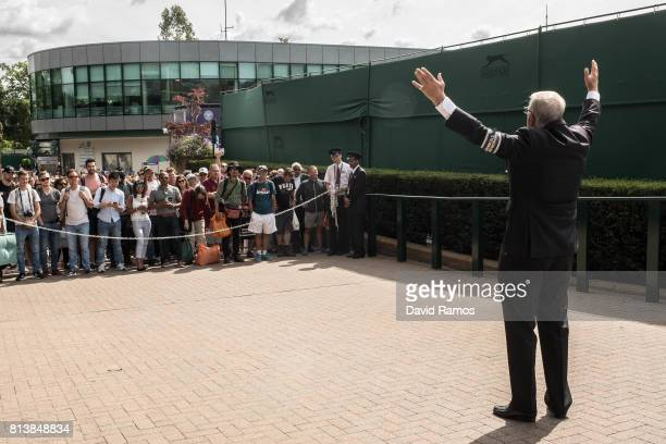 An Honorary steward welcomes tennis fans ahead of day ten of the Wimbledon Lawn Tennis Championships at the All England Lawn Tennis and Croquet Club...