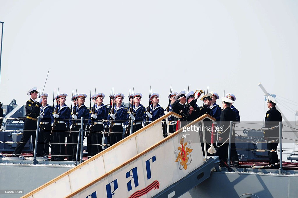 An honour guard ceremony is held on board of the Russian destroyer Admiral Vinogradov, berthed at the People's Liberation Army (PLA) naval base in Qingdao, northeastern China's Shandong province on April 23, 2012, prior to the start of the Sino-Russian joint naval exercises. China and Russia launched their first joint naval exercises, with war games in the Yellow Sea that come amid tensions between China and its Asian neighbours over territorial claims. CHINA