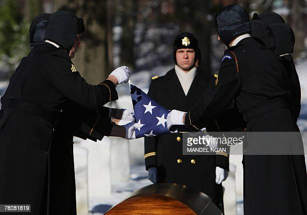 An honour guard folds the flag draping the casket containing the remains of Army 1st Lt Dixie Parker of Green Pond Alabama 06 December 2007 during a...