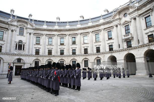 An honour guard of Scots Guards prepares to greet Indian Prime Minister Narendra Modi at treasury drum in London on November 12 2015 India's Prime...
