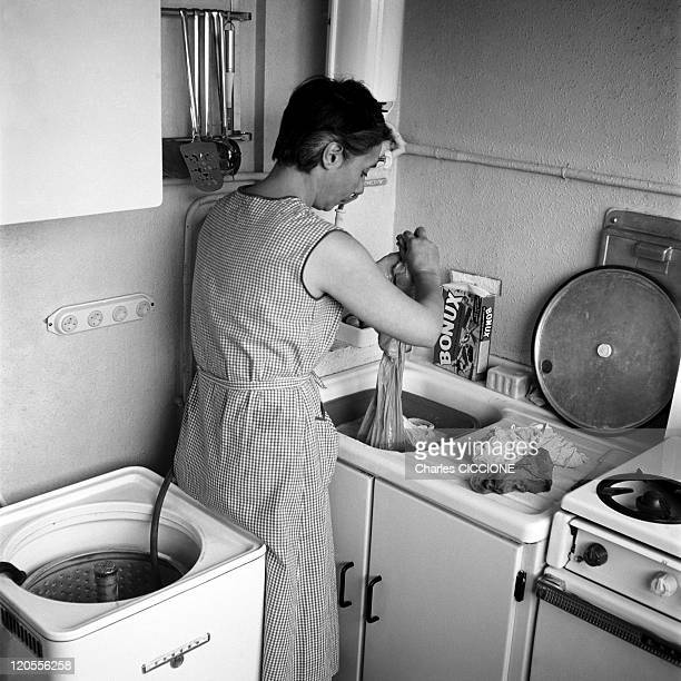 An Housewife Makes The Washing In Paris France In 1961 In her kitchen