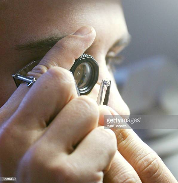 An HRD employee checks a diamond for color March 17 2003 in Antwerp Belgium The Diamond High Council is the official representation of trade and...