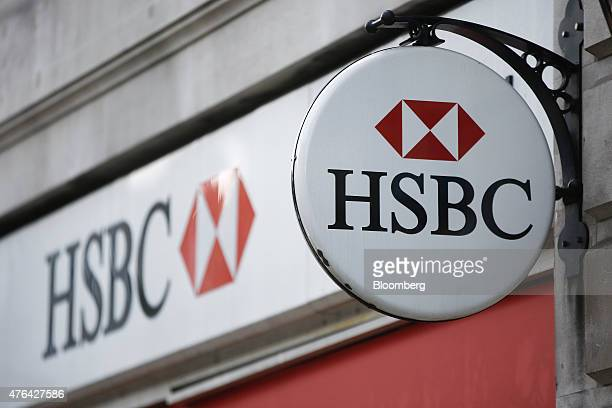 An HSBC logo sits on display outside an HSBC Holdings Plc bank branch in London UK on Tuesday June 9 2015 HSBC will eliminate as many as 50000 jobs...
