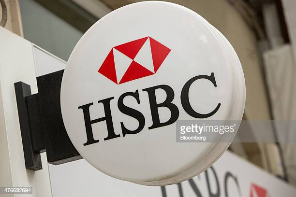 An HSBC logo sits on display outside an HSBC Holdings Plc bank branch in the Nisantasi district of Istanbul Turkey on Thursday June 11 2015 The...