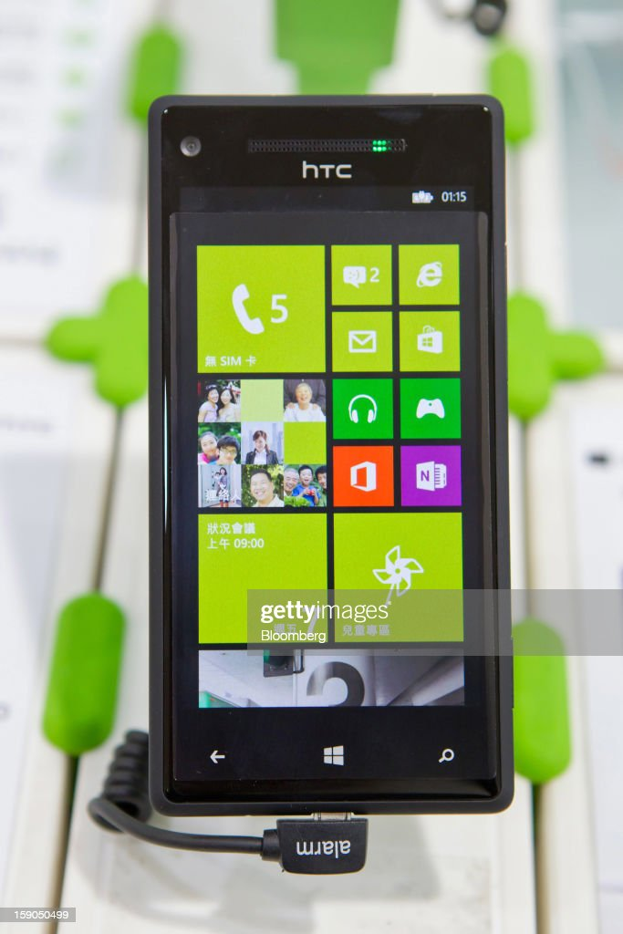 An HTC Corp. 8S smartphone is displayed at one of the company's stores in Taipei, Taiwan, on Sunday, Jan. 6, 2013. HTC is scheduled to release fourth-quarter earnings on Jan. 7. Photographer: Maurice Tsai/Bloomberg via Getty Images
