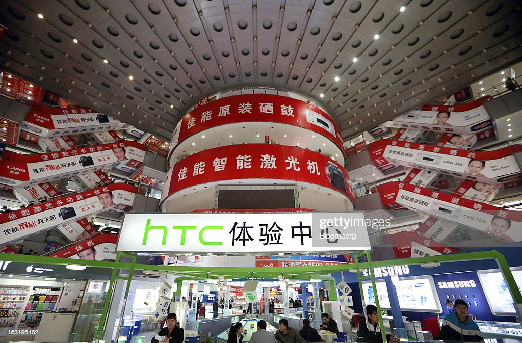 An HTC Corp. store is seen in front of Canon inc. advertisements displayed inside a shopping mall in Beijing, China, on Wednesday, March 6, 2013. China maintained its economic-growth target at 7.5 percent for 2013 while setting a lower inflation goal of 3.5 percent, setting up a challenge for new leaders to keep prices in check without harming expansion. Photographer: Tomohiro Ohsumi/Bloomberg via Getty Images