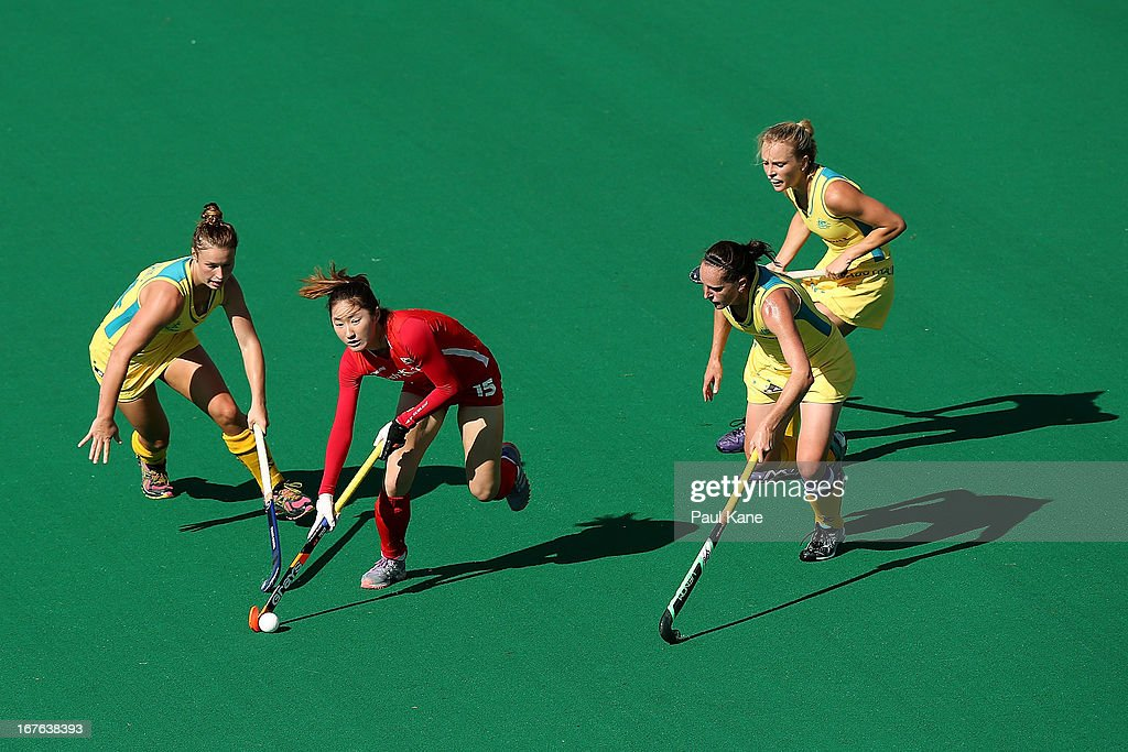 An Hyo Ju of Korea is challenged by Mariah Williams of Australia during the International Test match between the Australian Hockeyroos and Korea at Perth Hockey Stadium on April 27, 2013 in Perth, Australia.