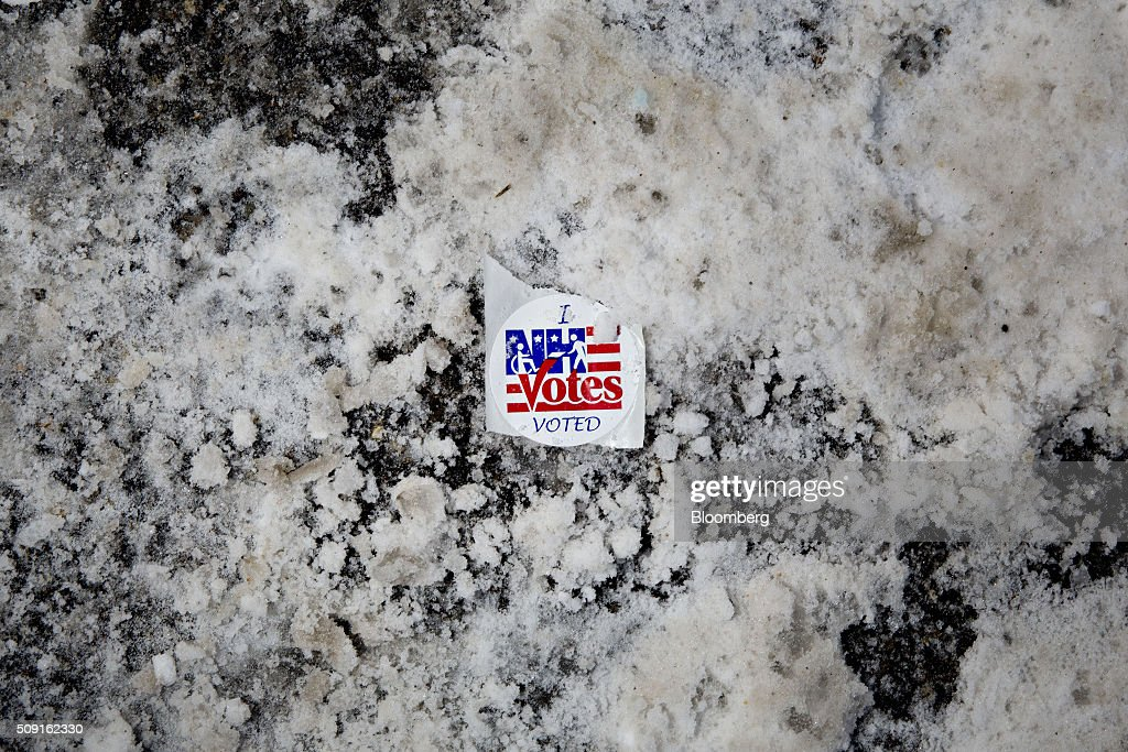 An 'I Voted' sticker sits on the ground outside a polling station in Manchester, New Hampshire, U.S., on Tuesday, Feb. 9, 2016. Voters in New Hampshire took to the polls today in the nations first primary in the U.S. presidential race. Photographer: Daniel Acker/Bloomberg via Getty Images