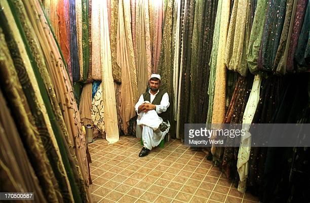 An Iarnian merchant sittin in his cloth shop in Zahedan city of Sistan Balouchistan south eastern province of Iran