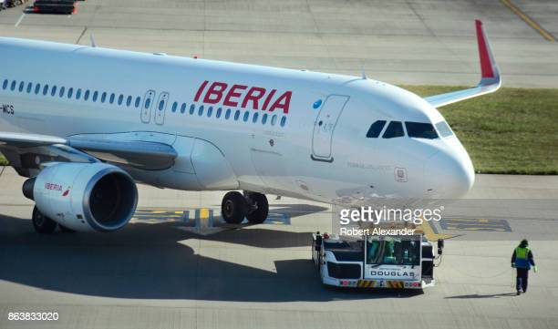 An Iberia Airlines passenger jet is pushed from its gate at Heathrow International Airport in London England