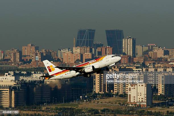 An Iberia airplane takes off in front of the Two Quio Towers on September 5 2014 in Madrid Spain Iberia British Airway's partner in IAG is on its way...