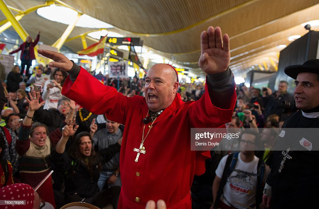 An Iberia worker drressed as the Pope addresses fellow workers during a protest at Barajas airport on March 4, 2013 in Madrid, Spain. Iberia workers have begun the second round of five day strikes in protest at plans by holding company IAG (International Consolidated Airlines Group), formed by the 2011 merger of Iberia and British Airways, to implement redundancies and pay cuts across the troubled Spanish airline.