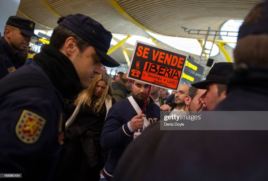 An Iberia worker holds a sign which reads 'For Sale, Iberia' during a protest at Barajas airport during a strike on March 4, 2013 in Madrid, Spain. Iberia workers have begun the second round of five day strikes in protest at plans by British based holding company IAG (International Consolidated Airlines Group), formed by the 2011 merger of Iberia and British Airways, to implement redundancies and pay cuts across the troubled Spanish airline. The strike is estimated to cause the cancelling of almost 1,300 flights this week, with a final round of five day strikes planned for March 18 to 22.