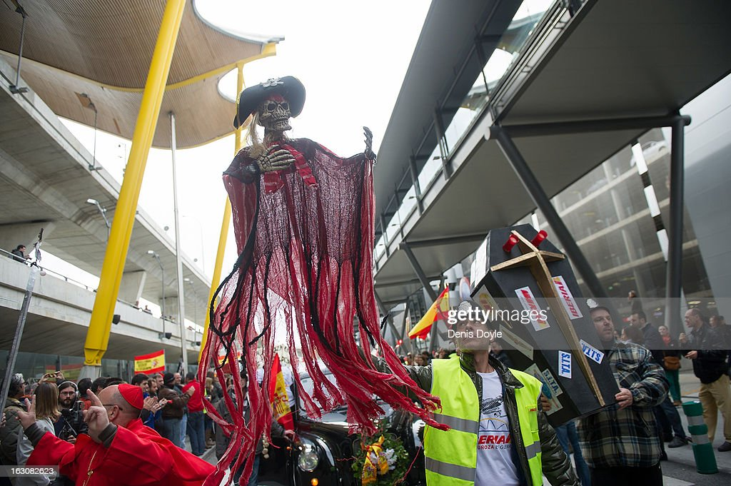 An Iberia worker holds an effigy representing the historical figure of English naval Vice Admiral Sir Francis Drake during a march at Barajas airport on March 4, 2013 in Madrid, Spain. Iberia workers have begun the second round of five day strikes in protest at plans by holding company IAG (International Consolidated Airlines Group), formed by the 2011 merger of Iberia and British Airways, to implement redundancies and pay cuts across the troubled Spanish airline. The strike is estimated to cause the canceling of almost 1,300 flights this week, with a final round of five day strikes planned for March 18 to 22.