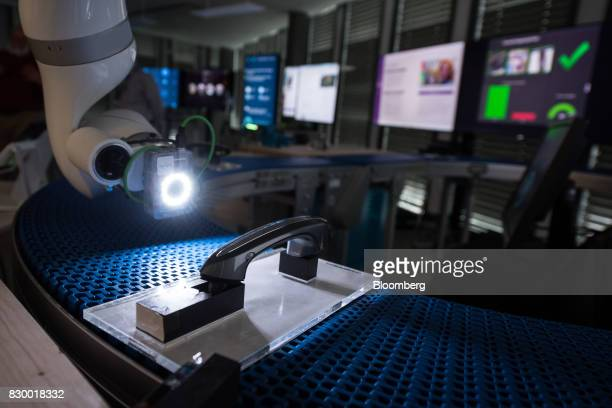An IBM Visual Inspection system illuminates an automobile door handle at the International Business Machines Corp Watson cognitive computing platform...