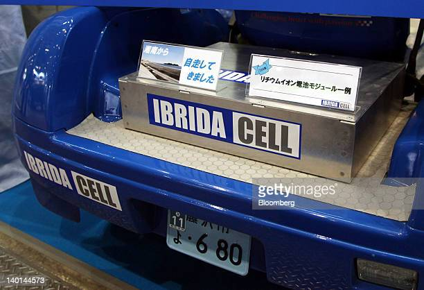 An Ibrida Cell Co BM1820CH lithiumion battery module is displayed on a cart during Smart Energy Week 2012 in Tokyo Japan on Wednesday Feb 29 2012 The...
