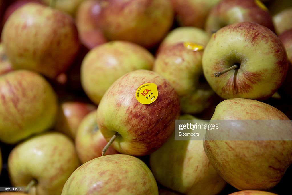 An ICA sticker sits on an apple for sale inside an ICA supermarket store in Stockholm, Sweden, on Tuesday, Feb. 19, 2013. Hakon Invest AB, the minority owner of Sweden's largest food retailer ICA, agreed to take full control by acquiring partner Royal Ahold NV's 60 percent stake for 20 billion kronor ($3.1 billion). Photographer: Casper Hedberg/Bloomberg via Getty Images