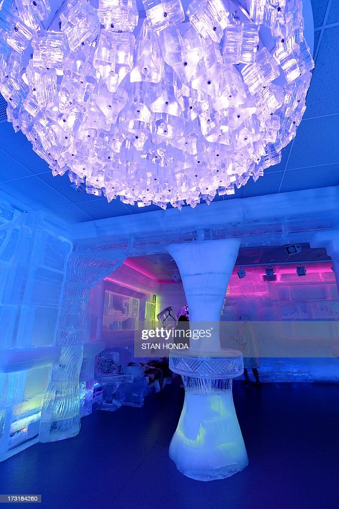 An ice 'chandelier' seen in the Minus 5 Ice Bar during a preview at the New York Hilton Midtown Hotel July 9, 2013 in New York. The bar is constructed of 90 tons of ice and is kept at a temperature of -5 degrees C (23 degrees F). Guests are given parkas, gloves and hats and for an additional fee, fur coats. Designs in the wall and around the bar are carved by ice sculptor Peter Slavin. AFP PHOTO/Stan HONDA