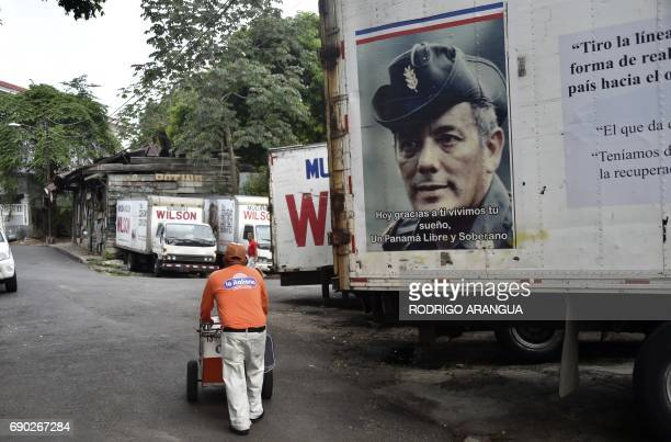 An ice cream vendor passes by a photograph of late General Omar Torrijos at El Chorrillo neighborhood which was the stronghold of late President...