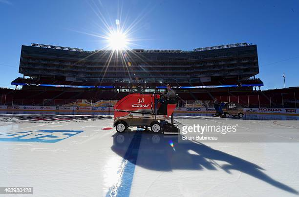 An ice crew worker resurfaces the ice for the San Jose Sharks practice one day prior to the 2015 Coors Light Stadium Series game between the Los...