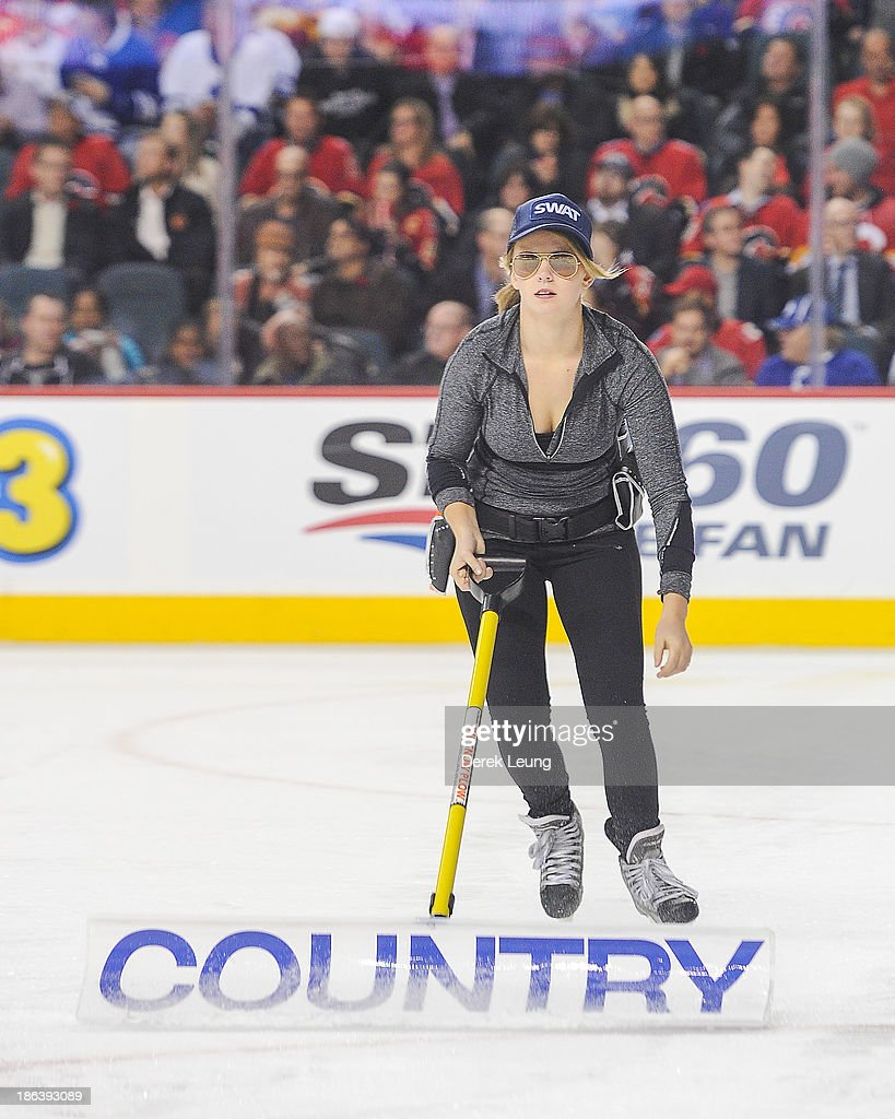 An ice girl wears her halloween costume as she cleans the ice during a break in play between the Calgary Flames and the Toronto Maple Leafs during an NHL game at Scotiabank Saddledome on October 30, 2013 in Calgary, Alberta, Canada.
