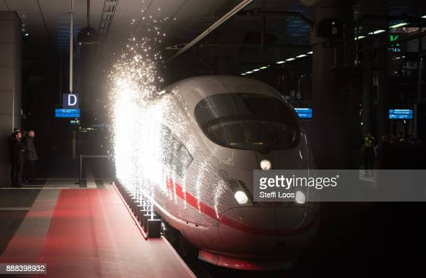 An ICE high speed train arrives at the main railway station in Berlin during an inauguration of a new fast route between Munich and Berlin on...