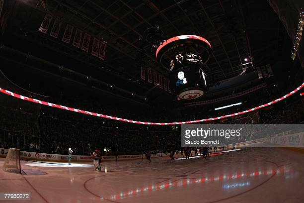 An ice level view shows players standing for the National Anthem before the Montreal Canadiens game against the Toronto Maple Leafs on November 13...