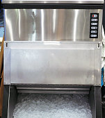 An ice making machine which placed in modern restaurant. Selective focus.