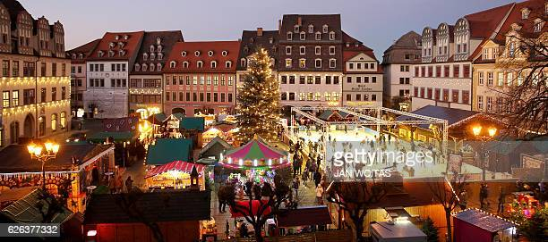 An ice rink is set up at the Christmas Market in Naumburg an der Saale eastern Germany on November 28 2016 / AFP / dpa / Jan Woitas / Germany OUT