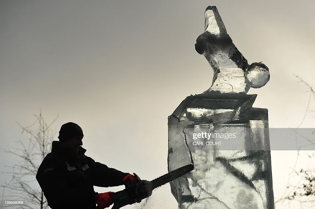 An Ice sculptor works on a block of ice during the London Ice Sculpting Festival in Canary Wharf, east London, on January 11, 2012. Competitors from Britain, the US, France, Hungary, Bulgaria, Spain, Sweden, Netherlands, Latvia, Belgium and Portugal are competing in the festival which runs from January 11-13, 2013. AFP PHOTO / CARL COURT