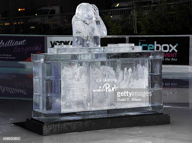 An ice sculpture shaped like a DJ booth is displayed as members of a Skating Dance Troop perform during a photocall to launch the Wembley Park Ice...