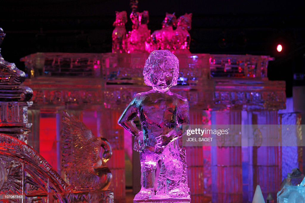 An ice sculptures showing a Manneken Pis and the Brandenburg's gate are exhibited on November 19, 2010 in Paris in a hall where the temperature is kept at -6°C as part of the exhibition Ice Magic world tour. AFP PHOTO JOEL SAGET