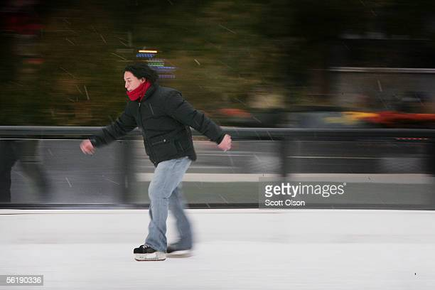 An ice skater glides around the rink at Millennium Park November 16 2005 in Chicago Illinois Wind chills in the city hovered in the single digits on...