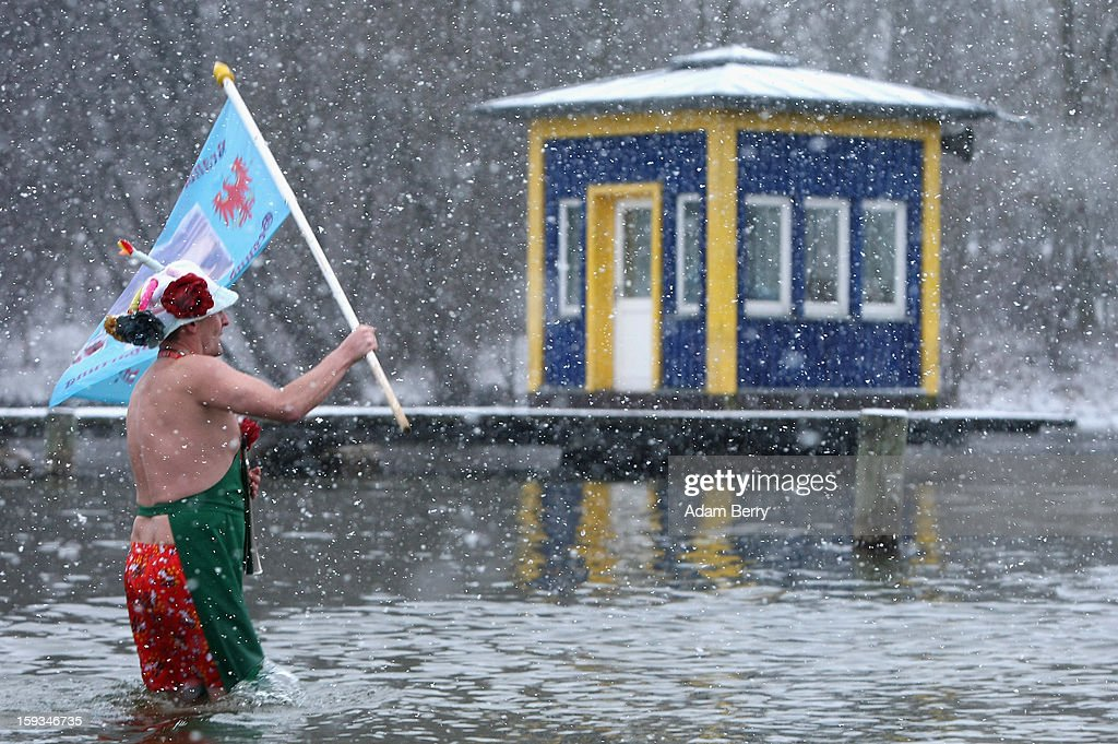An ice swimming enthusiast enters the cold waters of Orankesee lake during the 'Winter Swimming in Berlin' event on January 12, 2013 in Berlin, Germany. A local swimmers' group called the 'Berlin Seals' invite ice swimmers from across Germany and abroad to the annual event, which, despite warmer temperatures this winter and a lack of ice, was still held. Members claim ice swimming is good for the body's blood circulation.