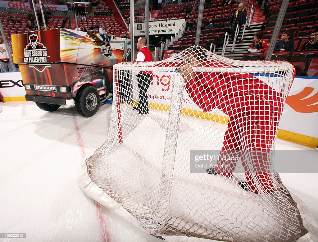 An ice technician take shelter in the net while the Zamboni rolls out onto the ice prior to the start of the game between the Florida Panthers and the Washington Capitals at the BankAtlantic Center on February 17, 2012 in Sunrise, Florida.