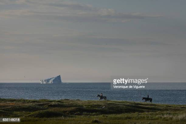 An iceberg floats in Boavista Bay off the coast of Newfoundland Canada As more icebergs drift south due to climate change a few enterprising...