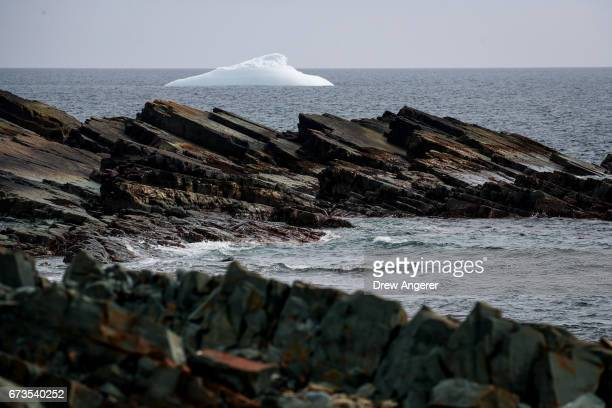An iceberg floats in the water off the coast of Portugal Cove South Newfoundland Canada April 26 2017 Icebergs break off from Baffin Island and...
