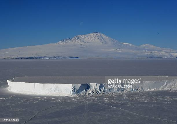 An iceberg lies in the Ross Sea with Mount Erebus in the background near McMurdo Station Antarctica on November 11 2016 US Secretary of State John...