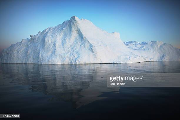 An iceberg that broke off from the Jakobshavn Glacier floats through the water on July 21 2013 in Ilulissat Greenland As the sea levels around the...