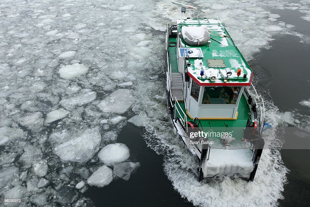 An icebreaker churns through ice in the Dahme river in the district of Koepenick on January 28, 2010 in Berlin, Germany. Though temperatures are mild today at around 0 degrees Celsius, northeastern Germany has struggled through a cold front in the last week that brought temperatures down to -20 degrees Celsius, and forecasters say they expect the cold front to return by the weekend.