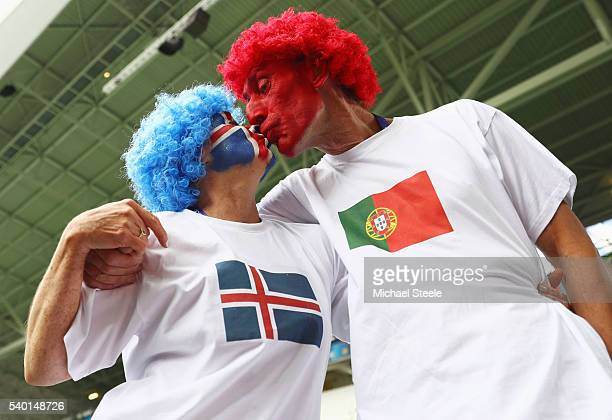 An Iceland fan and a Portugal fan share a kiss prior to the UEFA EURO 2016 Group F match between Portugal and Iceland at Stade GeoffroyGuichard on...