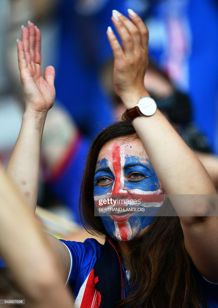 An Iceland supporter applauds prior to the Euro 2016 round of 16 football match between England and Iceland at the Allianz Riviera stadium in Nice on June 27, 2016. / AFP / BERTRAND