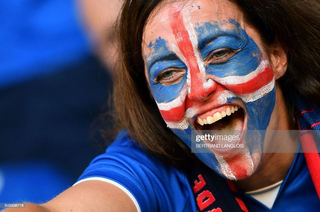An Iceland supporter cheers prior to the Euro 2016 round of 16 football match between England and Iceland at the Allianz Riviera stadium in Nice on June 27, 2016. / AFP / BERTRAND