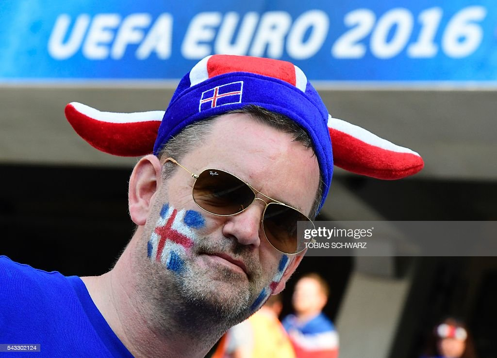 An Iceland supporter poses prior to the Euro 2016 round of 16 football match between England and Iceland at the Allianz Riviera stadium in Nice on June 27, 2016. / AFP / Tobias SCHWARZ