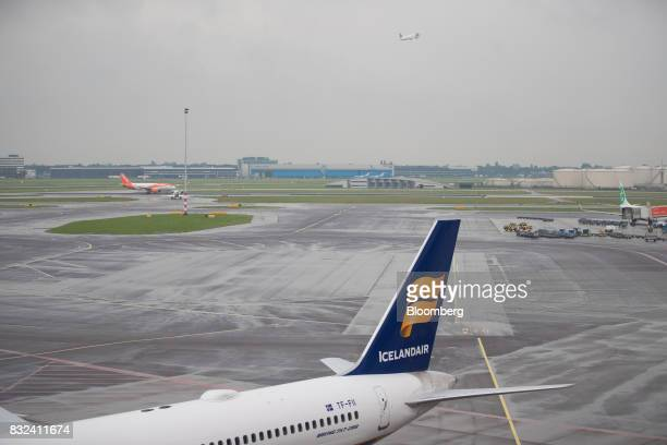 An Icelandair Group passenger plane stands on the tarmac at Schiphol airport in Amsterdam Netherlands on Tuesday Aug 15 2017 Delta Air Lines Inc...