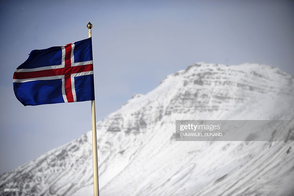 An Icelandic flag flies over Vik, a village sitting at the base of the Myrdalsjokull glacier, which is part of the ice cap sealing the Katla volcano, in Vik, on April 22, 2010. Katla, a volcano 10 times more powerful than neighbour Eyjafjallajökull, which erupted last week and impacted air traffic worldwide, has erupted in intervals of 40-80 years and its last eruption was in 1918. The village of Vik sits between the two main lava and glacial flood routes and has set up evacuation plans to abandon the village promptly if Katla erupts. AFP PHOTO/Emmanuel Dunand
