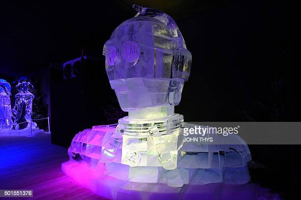 An icesculpture in the form of Star Wars character C3P0 is displayed during the Star Wars Ice sculpture festival in Liege on December 16 The wait is...