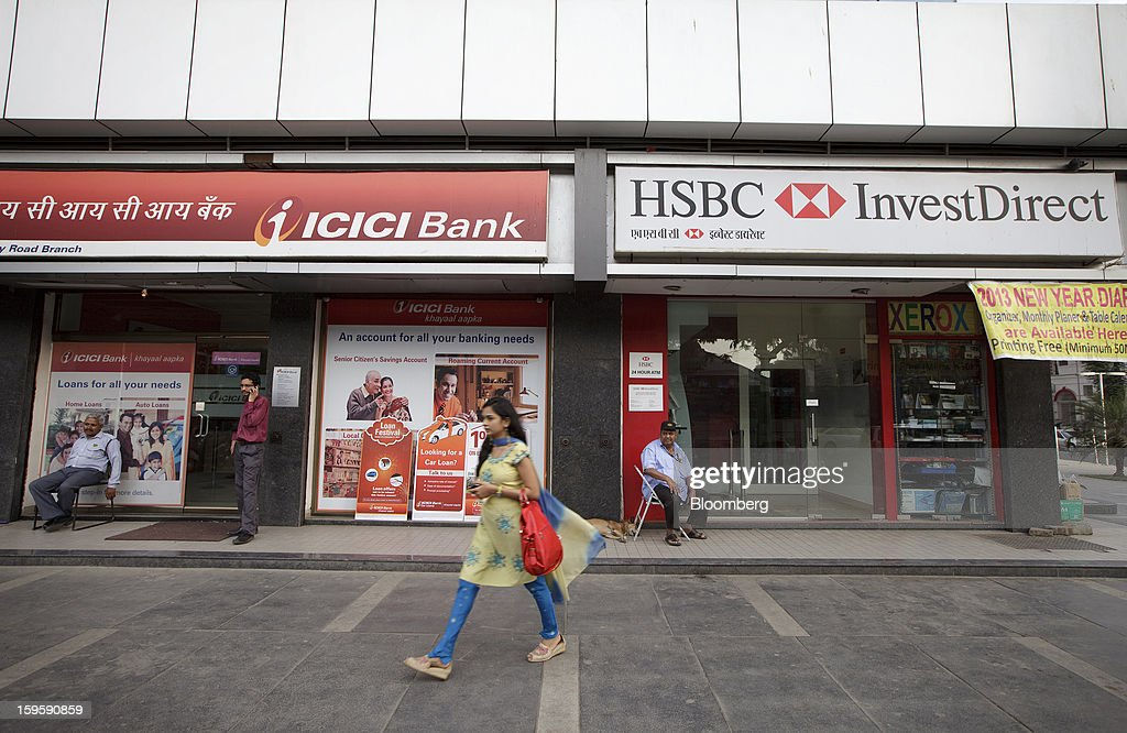 An ICICI Bank Ltd. branch stands next to an HSBC InvestDirect India Ltd. branch in Mumbai, India, on Wednesday, Jan. 16, 2013. India's financial system has been made vulnerable by a deterioration in bank assets and a lack of capital as the economy slowed, according to the International Monetary Fund. Photographer: Kuni Takahashi/Bloomberg via Getty Images