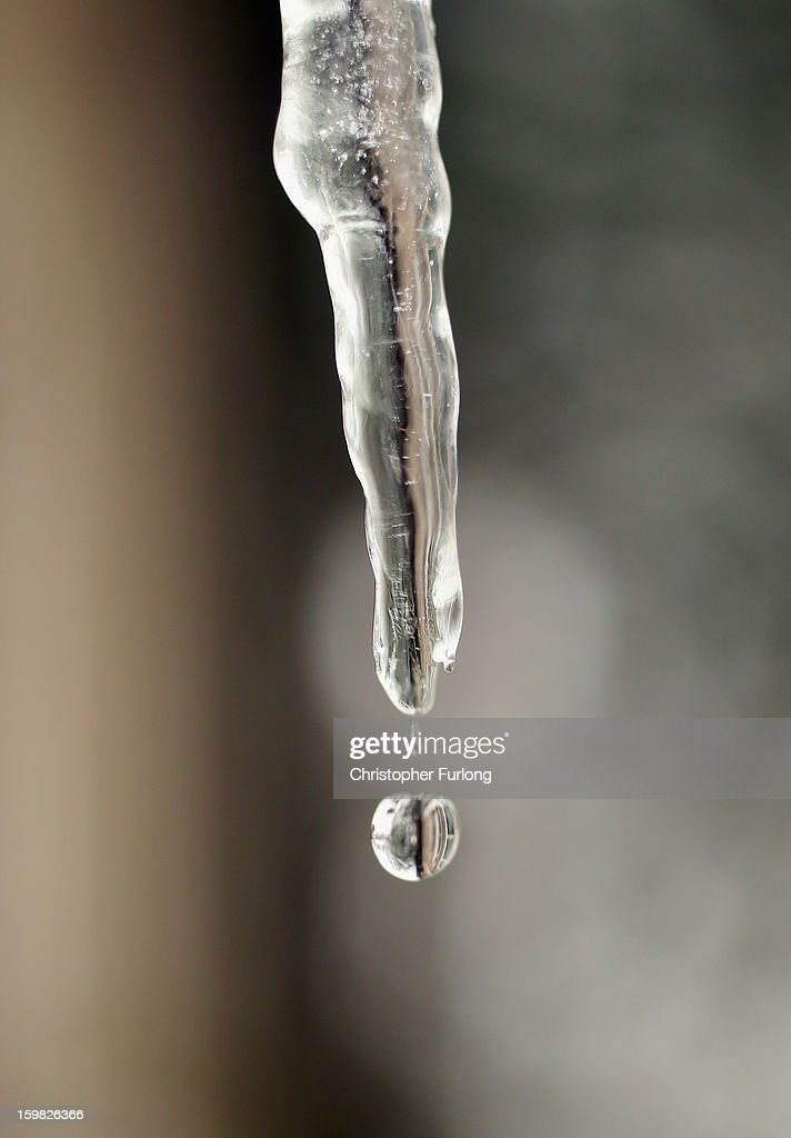 An icicle hangs from the roof of a cottage in the village of Tissington, Derbyshire, on January 21, 2013 in Ashbourne, United Kingdom. The Met Office has issued a red weather warning for parts of the Uk and advising against all non-essential travel as up to 30cm of snow is expected to fall in some areas today. The adverse weather has closed nearly 5,000 schools and caused many airports to cancel flights.